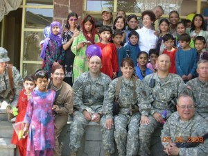 Cynthia's Soldier Group With Kids Overseas During Community Mission.
